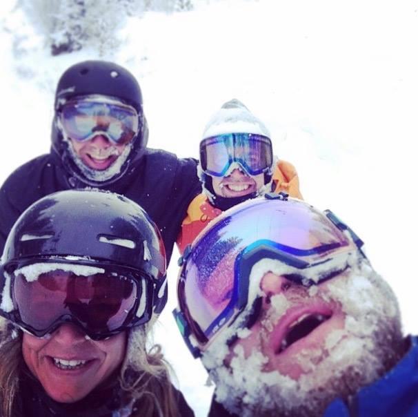 Jenny Jones pro Snowboarder snowboarding in powder with Olly from Mountain Mavericks