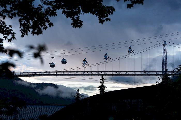 Morzine Cyclists on bridge Morzine Cycle destination