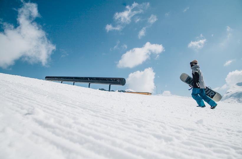 Snowboard hike shot in ski park avoriaz