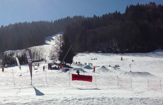 The sun shining for the Volcom/Slopestyle snowboard competition
